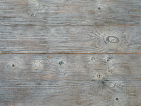 Background of the adored and tinted wooden boards. Minimalism. Wallpaper in the form of a tree texture. Banco de Imagens