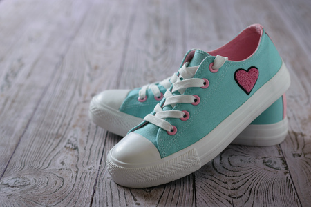 Beautiful turquoise sneakers on a pink wooden floor. Sport style. Reklamní fotografie