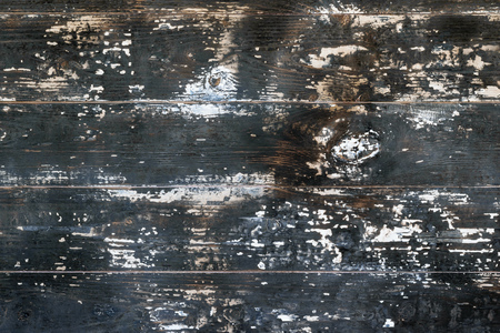 Wooden boards are subjected to a severe exposure to flame. Wallpaper in the form of a tree texture.