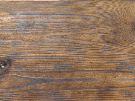 Two wooden pine planks covered with brown protective compound. Minimalism. Wallpaper in the form of a tree texture.