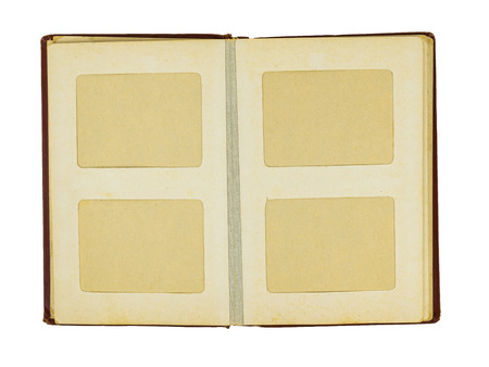 Old uncovered photo album with red cover isolated on white background. Flat lay The view from the top. Stock Photo