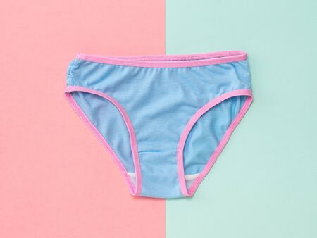 Blue womens panties on blue and pink background. The concept of meeting lovers. Underwear. The view from the top. Beautiful lingerie. Flat lay. Imagens
