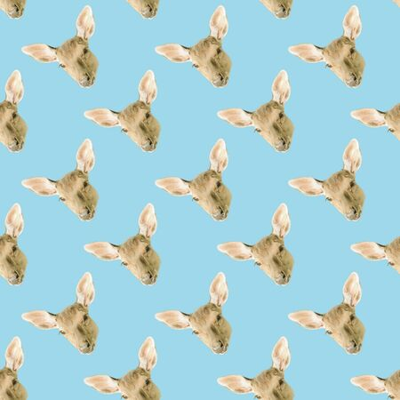 Seamless pattern of the head of a deer isolated on a blue background. Herbivorous wild animal.
