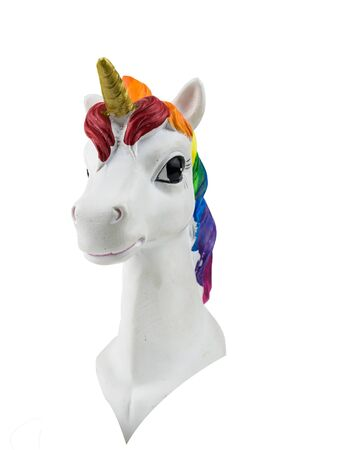The head of a unicorn figure with a Golden horn isolated on a white background. Trend. Minimalism. Lifestyle. Stock Photo