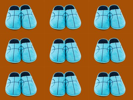 Seamless pattern of blue Slippers on a brown background. Comfortable home shoes. Stock Photo