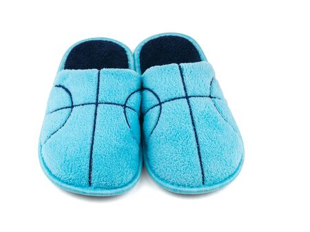 Front view of blue Slippers isolated on white background. Comfortable home shoes.