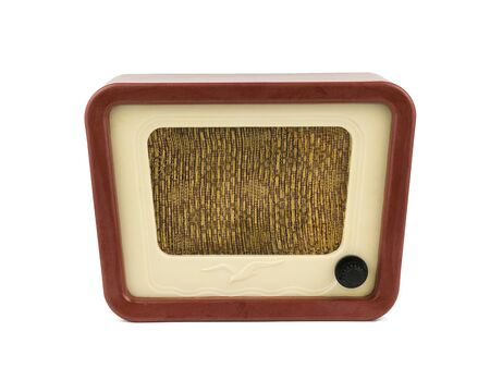 Front view of vintage radio isolated on white background. Radio engineering of the past time. Retro design. Imagens