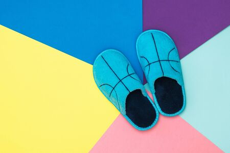 Top view of soft Slippers on a colorful background. Comfortable home shoes. Flat lay.