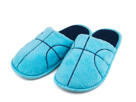 Dark blue embroidery on blue Slippers isolated on white background. Comfortable home shoes.