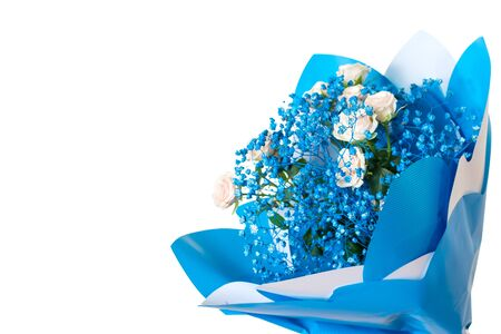 Bouquet of light roses and small blue flowers isolated on a white background. A gift for a woman. Festive mood.
