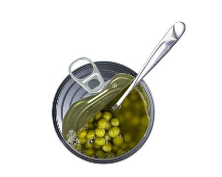 Open jar with green peas and a spoon isolated on a white background. Universal container for canning.