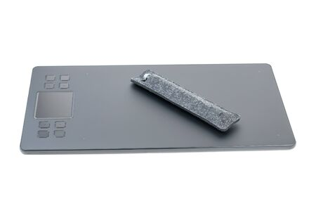 Graphic tablet with a pencil in a case isolated on a white background. A device for working in image editors.