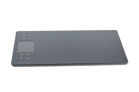Black graphic tablet isolated on a white background. A device for working in image editors.