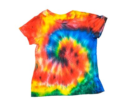 T-shirt in a bright tie dye style isolated on a white background. White clothes painted by hand. Flat lay. Place for text. Pastel color.