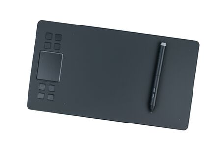 Top view of a graphic tablet with a pencil isolated on a white background. A device for working in image editors.