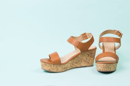 Summer leather sandals on a blue background. Summer shoes for women.