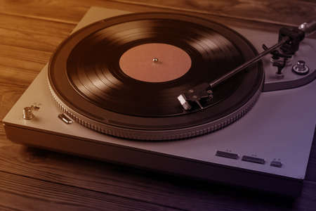Two-color toning of the image of the vinyl disc player. Music on vinyl discs. Archivio Fotografico