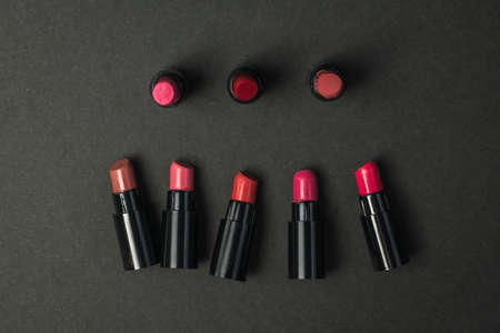 Several samples of lipstick on a black background. Cosmetics for lips.