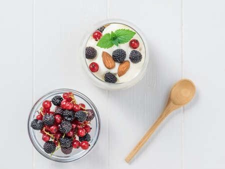 Milk, almonds and granola in a clay bowl on a wooden table. Vegetarian food with prebiotics.