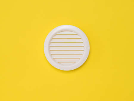 White ventilation grate on a yellow background. Devices for fresh air supply.