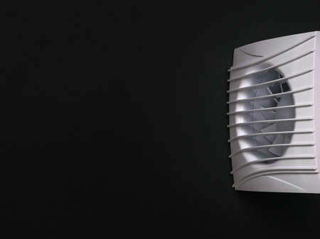 White exhaust fan on a black background. Equipment for the removal of dirty air.