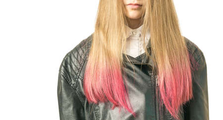 A girl with dyed hair in a leather jacket isolated on a white background. Style and fashion.