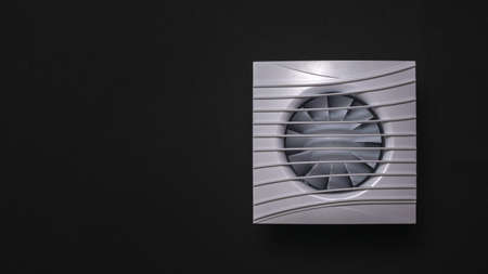 Square white duct fan on a black background. Equipment for the removal of dirty air. Stock Photo