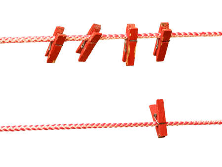 Two clotheslines with red clothespins isolated on a white background. Device for drying clothes.