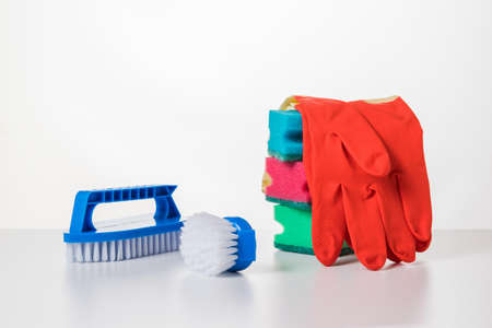 Cleaning kit consisting of brushes, gloves and cleaning powder. The concept of cleaning and maintaining cleanliness. 写真素材