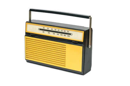 Black and yellow orange retro radio isolated on a white background. Vintage technique.