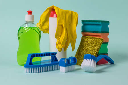 A set of rags, brushes and cleaning products for washing dishes and cleaning. The concept of cleaning and maintaining cleanliness. 写真素材