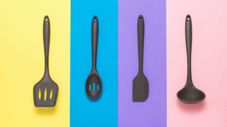 Set of silicone kitchen accessories on a colored background. Kitchen appliances. 写真素材