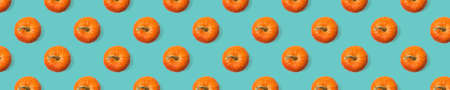 Seamless pattern of ripe pumpkins on a blue background. Isolated pumpkin fruit.