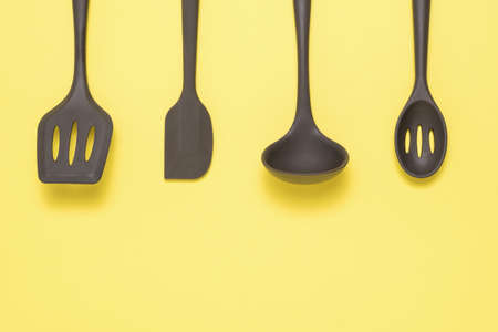 Kitchen set made of silicone on a yellow background. Kitchen appliances.