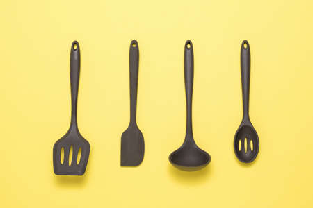 Kitchen accessories made of brown silicone on a yellow background. Kitchen appliances.