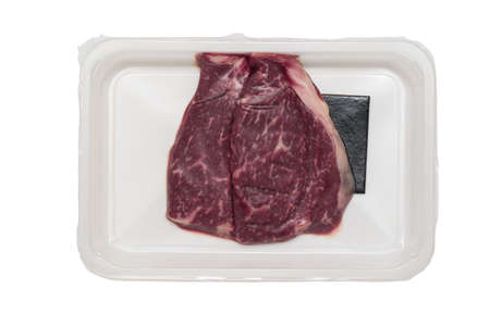 Vacuum-Packed beef steaks isolated on a white background. Sealed packaging for meat.