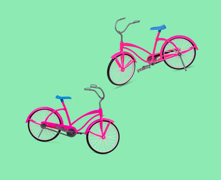Two pink bicycles on a green background. Eco-friendly mode of transport.