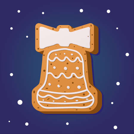 Christmas gingerbread in the shape of a bell on a blue background. Traditional pastries for Christmas and New year.