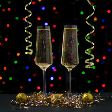Christmas card with two glasses of sparkling wine on the background of bokeh. Meeting of Christmas and new year. Stock fotó