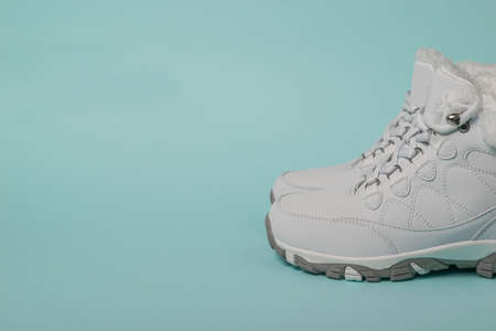 White women's running shoes with fur for winter sports. Sports shoes for winter.