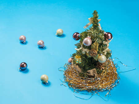 Christmas tree and scattered glass balls on blue Stock fotó