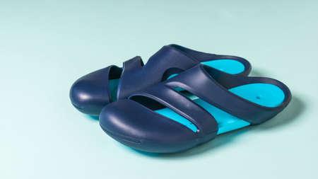 Large blue men's flip-flops isolated