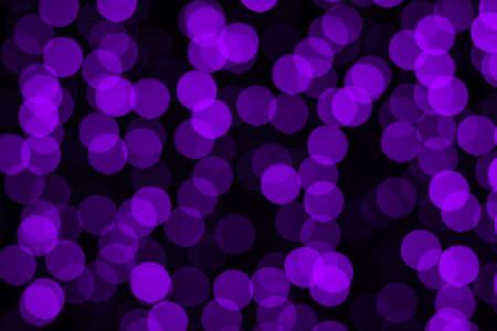 Blurry bokeh in purple on black.