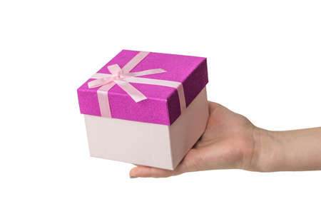 Hand with gift box isolated on white background. Surprise in the hands of a girl.