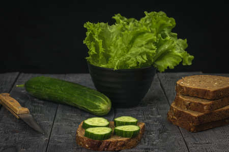 Preparation of snacks from cucumbers and whole-grain bread. Healthy eating.