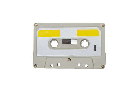 Gray-yellow retro tape recorder isolated on a white background. Retro carrier of audio information.