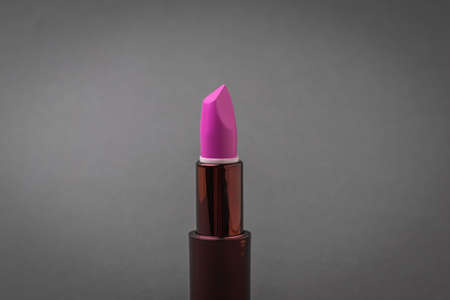 Bright lipstick on a dark gray background. Care for the female face. Stock fotó