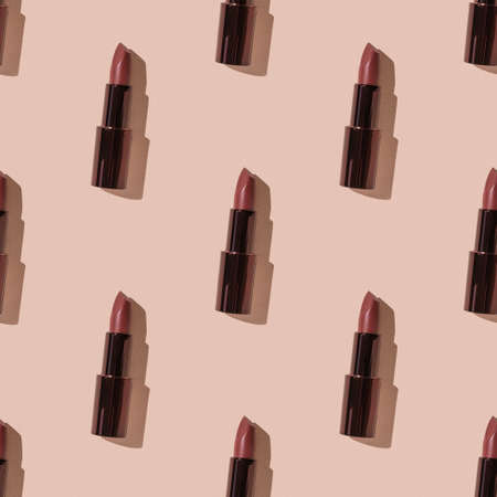 A seamless pattern of dark lipstick in bright light on a beige background. Lip decoration.