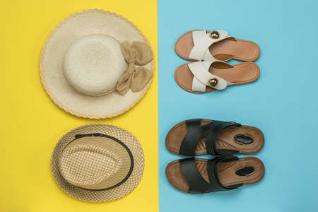 Women's and men's hats and women's and men's sandals. The concept of a family summer vacation.