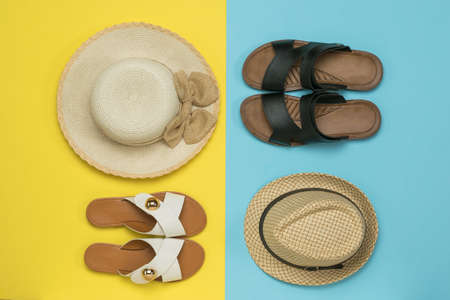 A set of men's and women's summer shoes and hats. The concept of a family summer vacation.